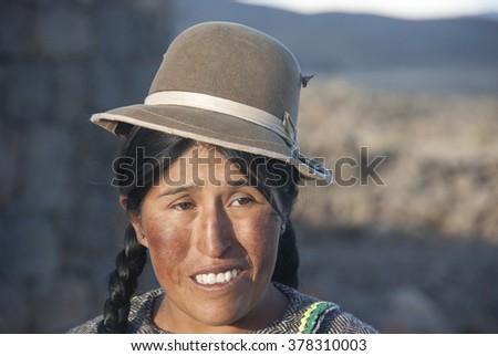CUZCO, PERU - NOVEMBRE  2008: A unidentified woman with Alpaca pose for the camera  in Cuzco, Peru. - stock photo