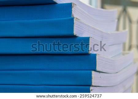 cyan book saddle  - stock photo