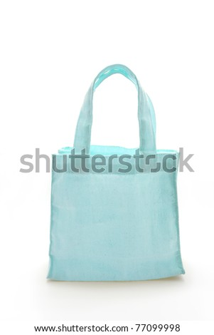 Cyan Cotton bag on black isolated background with a clipping path. - stock photo