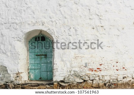 cyan door on white wall background - stock photo
