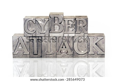 cyber attack phrase made from metallic letterpress type on reflective surface - stock photo