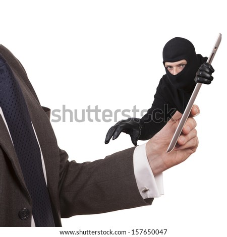 Cyber theft. A man wearing a suit is holding a tablet computer while a cyber criminal is reaching through screen to steal. white background.  - stock photo