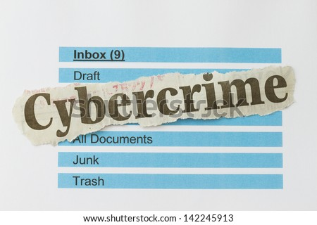 Cybercrime newspaper cutout over an email inbox abstract. - stock photo