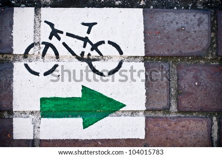 Cycle path sign on the brick wall - stock photo