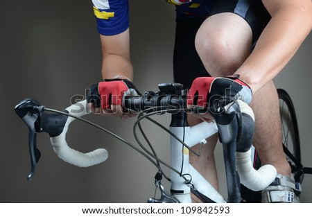 Cycler riding on bike in studio - stock photo