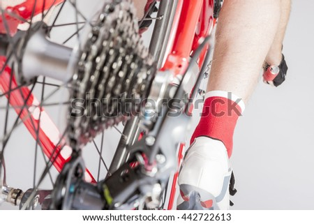 Cycling Concepts and Ideas. Back View of the Athlete Leg Inline with Rear Derailleur and Cassette Sprokets. Back View. Horizontal Image - stock photo