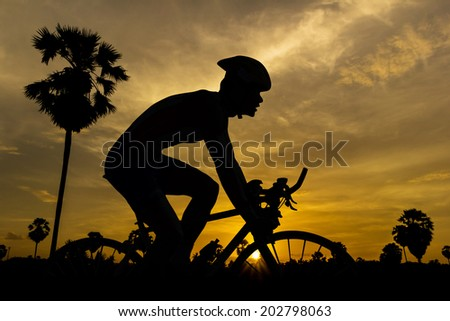 Cycling on sunset time in Thailand triathlon - stock photo