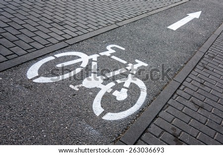 Cycling path signage on a pavement - stock photo