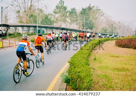 Cycling race on hill - stock photo
