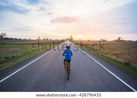 Cycling tour on the road - stock photo
