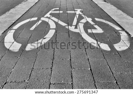 Cycling track with a drawing of a bicycle - stock photo