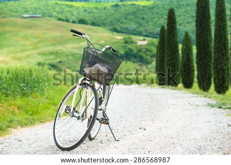 Cycling trip in the spring landscape of Tuscany. - stock photo