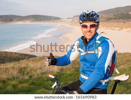 Cyclist expressing positivity with ok symbol outdoors - stock photo