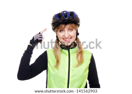 cyclist girl pointing to the helmet - stock photo