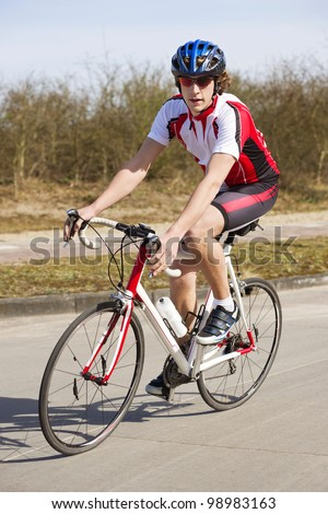 Cyclist on a racing bike, looking at the camera - stock photo