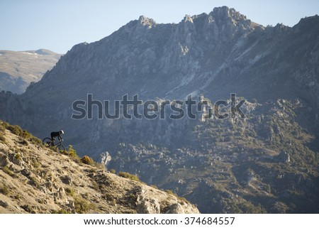 Cyclist riding a mountain bike downhill style. Extreme sports on a bicycle outdoors. - stock photo