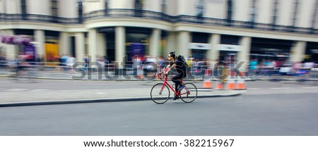 Cyclist Riding Bike Fast Through City. Speed Blur - stock photo