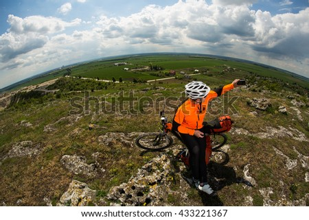Cyclist taking picture with smart phone. - stock photo