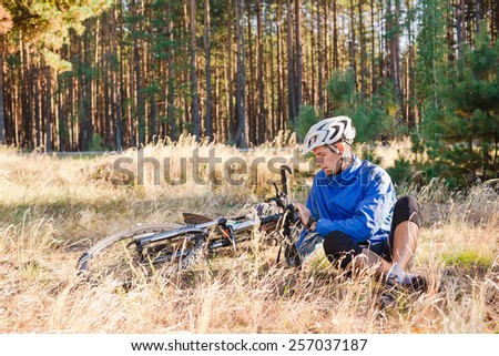 Cyclist with bicycle have a rest  - stock photo