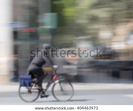 cyclists in the city, blurred, moving with Copy Space - stock photo
