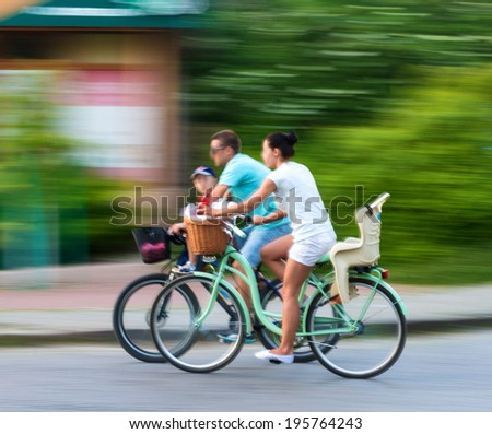 Cyclists on the city roadway in motion blur - stock photo