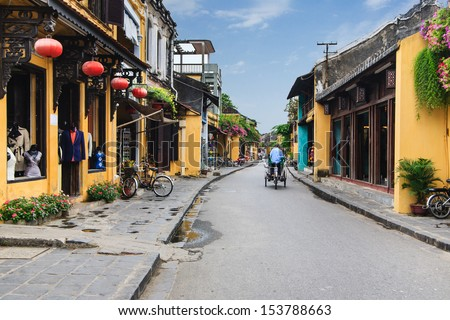 """Cyclo (called """"Xich Lo"""") in Hoi An Ancient Town, Quang Nam, Vietnam. Cyclo used to be a popular transportation in Vietnam, it is for tourism now. - stock photo"""