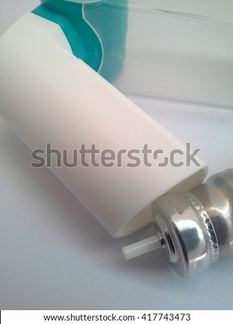 Cylinder  inhaler  on  white  background - stock photo