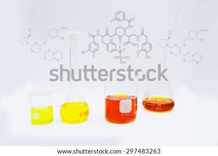 Cylinder, liquid chemicals laboratory - stock photo