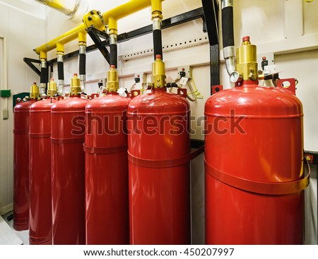 Cylinders and pipe fittings of industrial extinguishing system. - stock photo