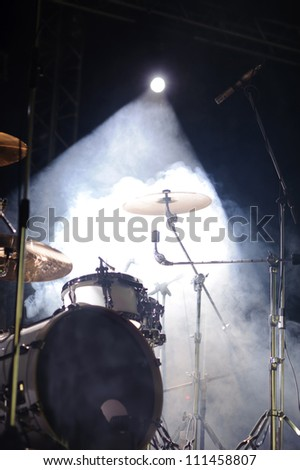 cymbals set in light of searchlights - stock photo