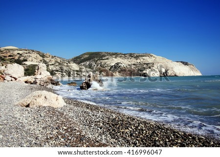 Cyprus coastline shoreline showing the Mediterranean sea with a blue sky and sea - stock photo