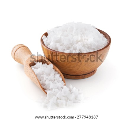Cyprus sea salt flakes in a wooden bowl isolated on white background - stock photo