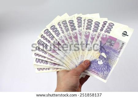 Czech money in hand, thousands - stock photo