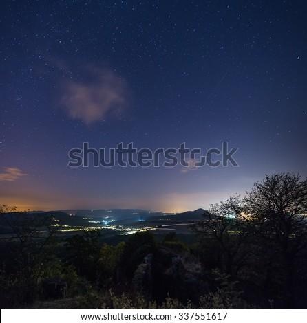 Czech mountains night, Milky Way, coast, stones, night, chair under the stars - stock photo