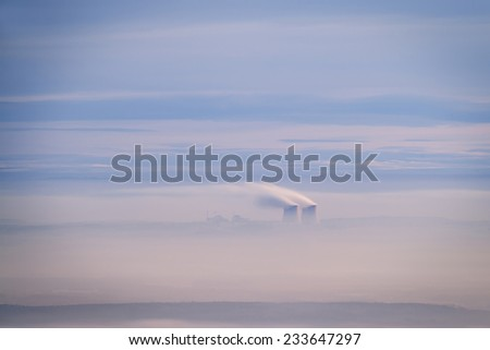 Czech Nuclear power plant Temelin blurred in a morning fog - stock photo