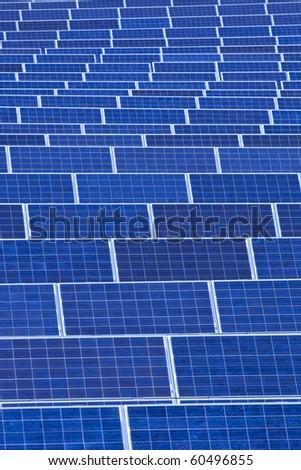 czech republic, bohemia - sunlight collectors at solar panel station - stock photo