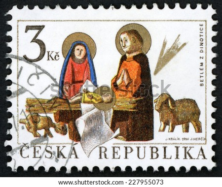 CZECH REPUBLIC - CIRCA 1996: Christmas post stamp printed in Czechoslovakia (Ceska) shows carved folklore figurines; birth of jesus Christ at bethlehem; betlem z Dinotice; Scott 3000 3k, circa 1996 - stock photo