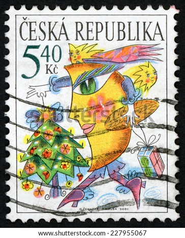 CZECH REPUBLIC - CIRCA 2001: Christmas post stamp printed in Czechoslovakia (Ceska) shows walking moon with two stars holding light up tree and gift; Scott 3159 A1202 5.40k multicolor, circa 2001 - stock photo