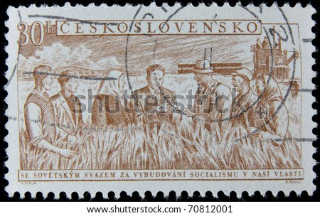 CZECH REPUBLIC - CIRCA 1960s : A post stamp printed in Czechoslovakia shows farmers on wheat field,  circa 1960s - stock photo
