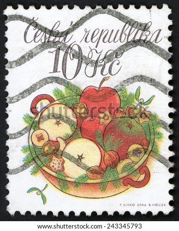 CZECH REPUBLIC - CIRCA 2008: stamp printed in Ceska shows bowl with apples, nuts, vanilla and linzer cookies, tree branches, mistletoe as decoration; Christmas tradition; Scott 3404 10k, circa 2008 - stock photo