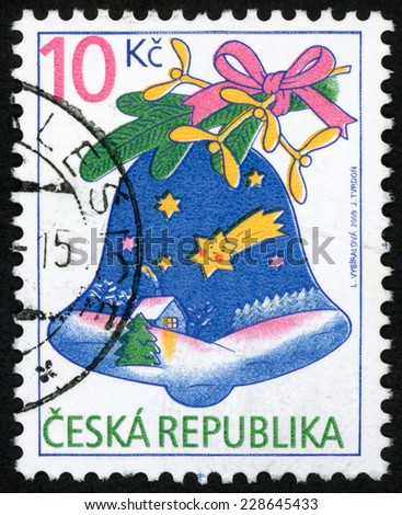 CZECH REPUBLIC - CIRCA 2009: stamp printed in Czechoslovakia (Ceska) shows illustration of christmas bell on tree branch decorated with house & stars on snowy winter night; 10k multicolor, circa 2009 - stock photo