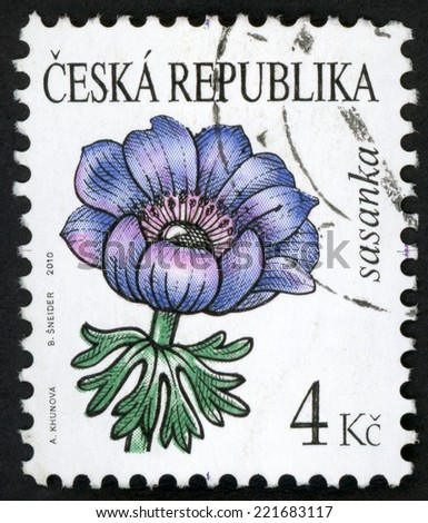 CZECH REPUBLIC - CIRCA 2010: stamp printed in Czechoslovakia (Ceska) shows illustration of blue anemone (sasanka) flower on white; beauty of flowers series; 4k blue violet purple green, circa 2010 - stock photo
