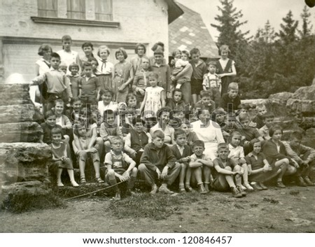 CZECHOSLOVAK REPUBLIC, CIRCA 1950 -  Classmates in front chalet. Elementary School on a trip in the countryside - Circa 1950 - stock photo