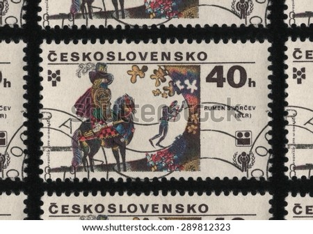 "CZECHOSLOVAKIA - CIRCA 1979: A postage stamp from the ""International Year of the Child and Biennial Exhibition of Children's Book Illustrations, Bratislava"" issue. Illustration by Rumen Skorcev.  - stock photo"