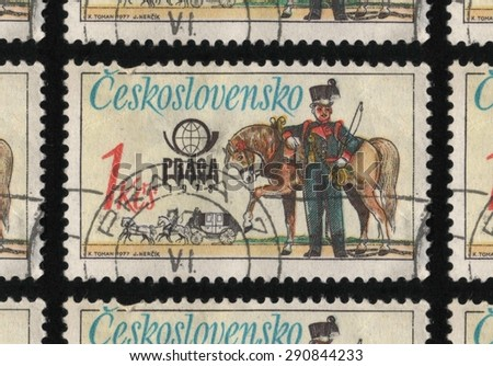 "CZECHOSLOVAKIA - CIRCA 1977: A postage stamp printed in Czechoslovakia from the ""PRAGA 78 International Stamp Exhibition - Historic Post Uniforms"" issue, shows a postal worker standing next to a horse - stock photo"