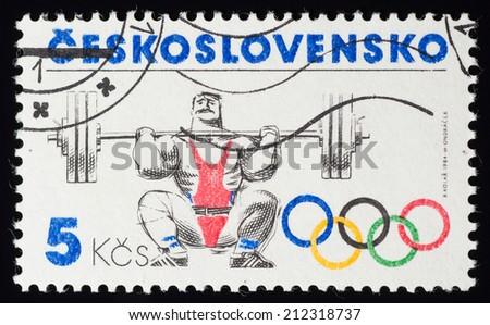 CZECHOSLOVAKIA - CIRCA 1984: A postage stamp printed in CZECHOSLOVAKIA shows Weightlifting in 1984 Sarajevo Olympic games,  circa 1984 - stock photo