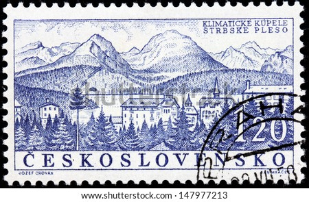 CZECHOSLOVAKIA - CIRCA 1958: A stamp printed by Czechoslovakia shows beautiful view of Strbske Pleso - a favorite ski, tourist, and health resort in the High Tatras, Slovakia, circa 1958. - stock photo