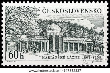 CZECHOSLOVAKIA - CIRCA 1958: A stamp printed by Czechoslovakia shows view of Marianske Lazne (Marienbad) - a spa town in the Karlovy Vary Region of the Czech Republic, circa 1958. - stock photo