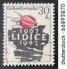CZECHOSLOVAKIA - CIRCA 1967: a stamp printed in  Czechoslovakia celebrates twenty-fifth anniversary of Lidice destruction. Czechoslovakia, circa 1967 - stock photo
