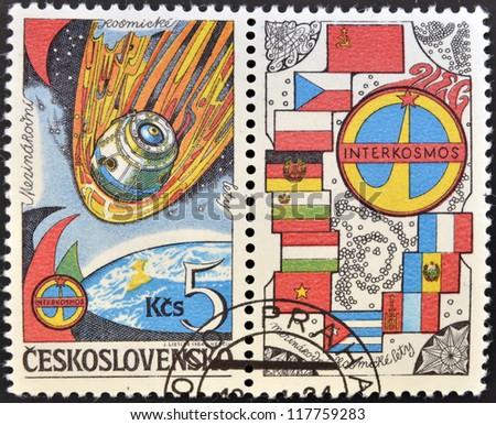 CZECHOSLOVAKIA - CIRCA 1984: A stamp printed in Czechoslovakia dedicated to Soviet Intercosmos program shows orbital station and flag, circa 1984 - stock photo